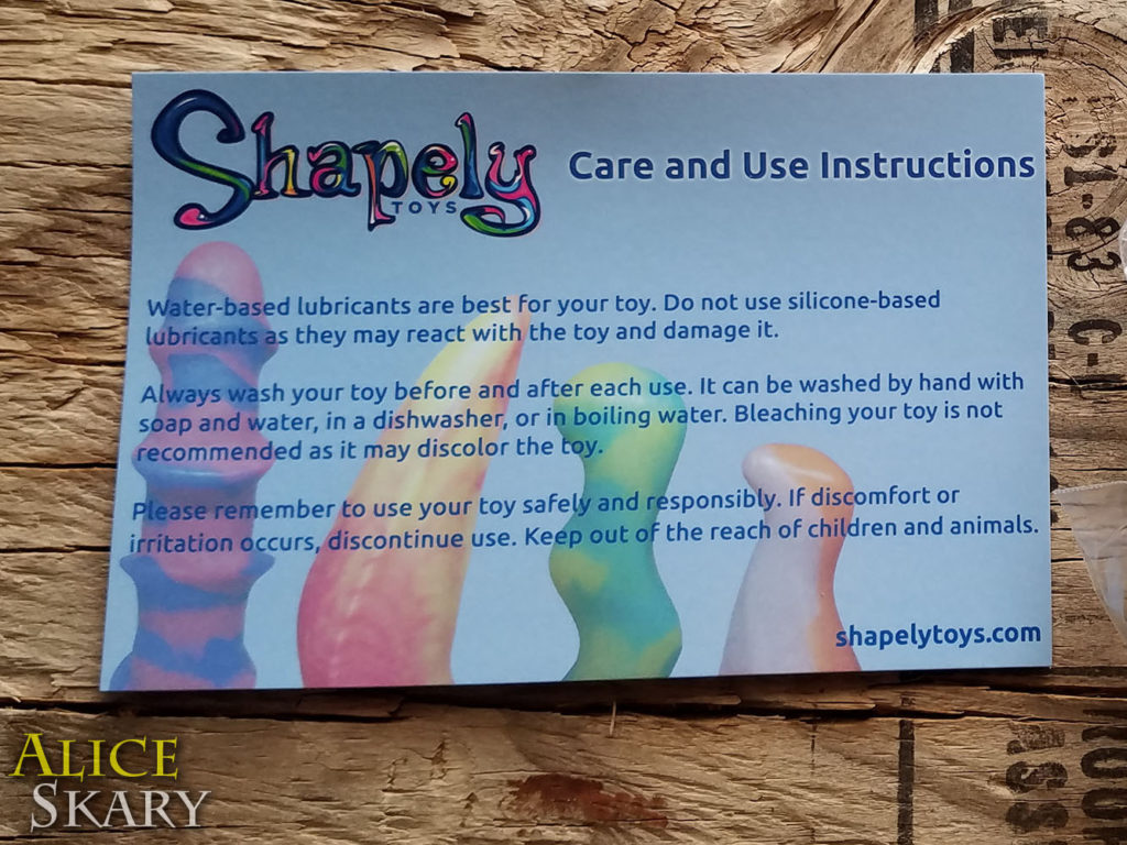 Pictured is a postcard with Care Instructions for The Rhombus buttplug from Shapely Toys