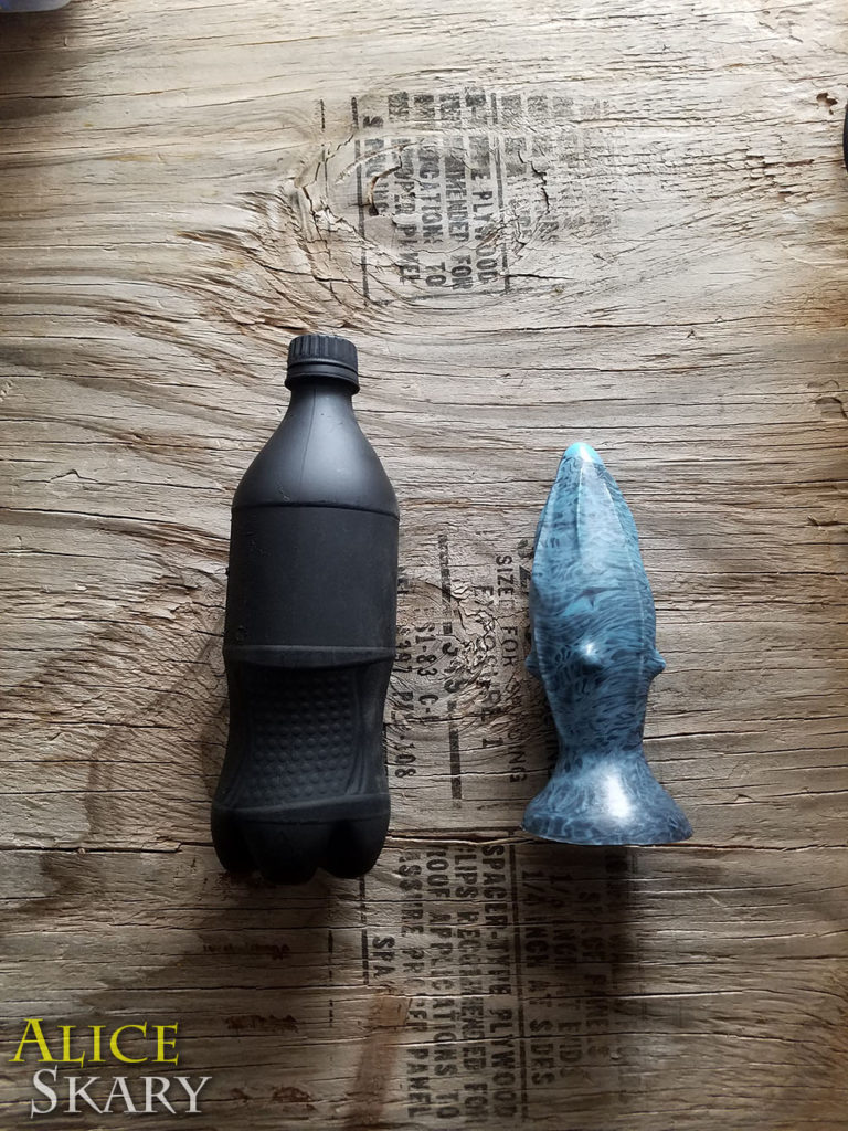 The Rhombus plug from Shapely Toys next to a cola bottle